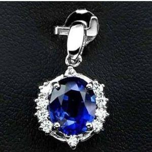 2 CT Lab created blue sapphire white topaz pendant